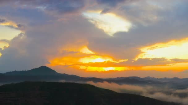 aerial photography light through the cloud above mountain at sunset