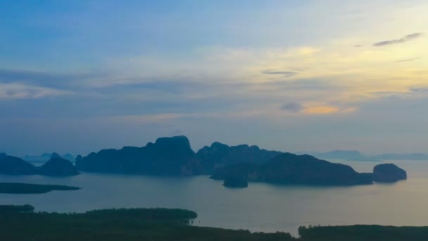 aerial photography sunrise at Samet Nangshe viewpoint in Phang Nga Thailand. a lot of islands in the sea can see from the hill. many tourists come for watching during sunrise