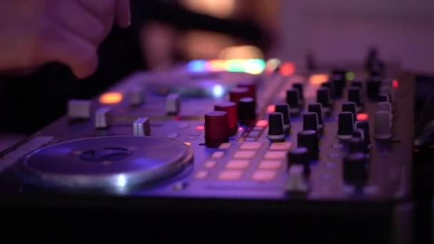 Close up of dj playing party music on modern cd usb player in disco club
