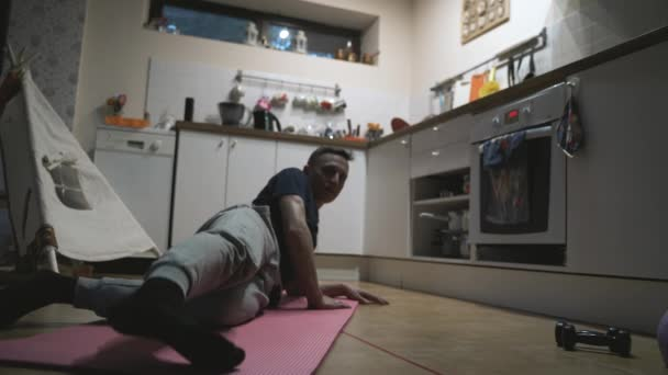 Handsome Man Exercising and Doing Push ups in The Kitchen at Home