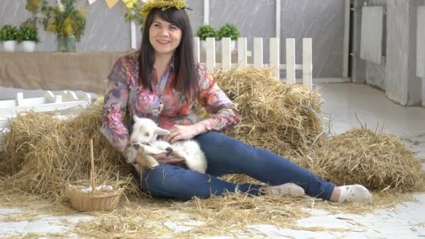 Attractive Brunette Girl Sitting And Holding Goat