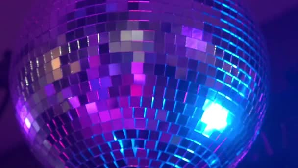 Slow Motion Disco Ball Reflecting Colorful Lights In Nightclub