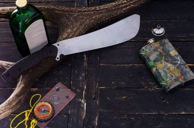 Alcohol and weapons. A tool for cutting cane. Top.