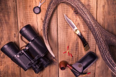 Things hunter. Knife and binoculars hunter. Binoculars and compass tracker.