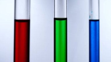 Test tubes with reagents on a white background.