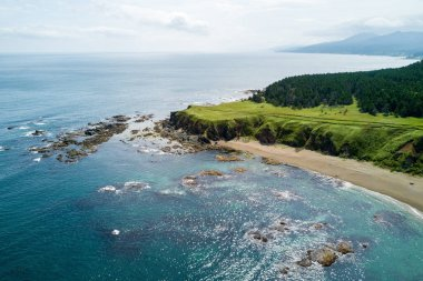 Aerial drone photo of cape Velikan, near by cape Ptichiy, Sakhalin island, Russia. Sahalin. Unbelievable natural green lawns. Northern Pacific Ocean. Sea of Okhotsk