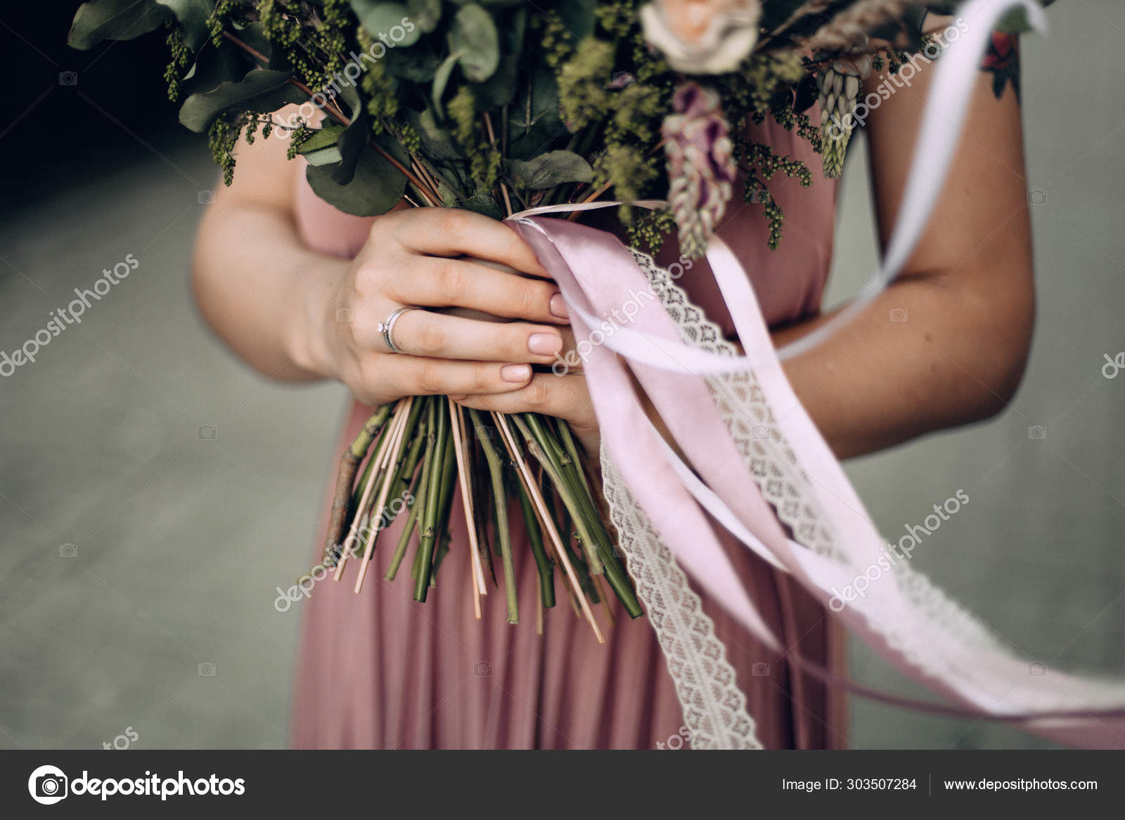 Happy And Smiling Woman With Bouquet Of Flowers In A Pink Wedding