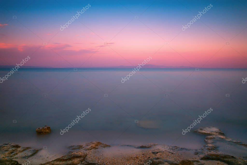 Beautiful colorful long exposure sunrise seascape shot in Afytos, Chalkidiki, Greece