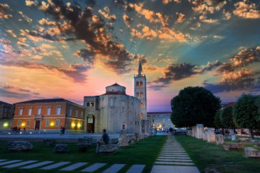 Dramatic sky in Sunset above the old roman square in Zadar, Croatia, with the ancient church of St Donat