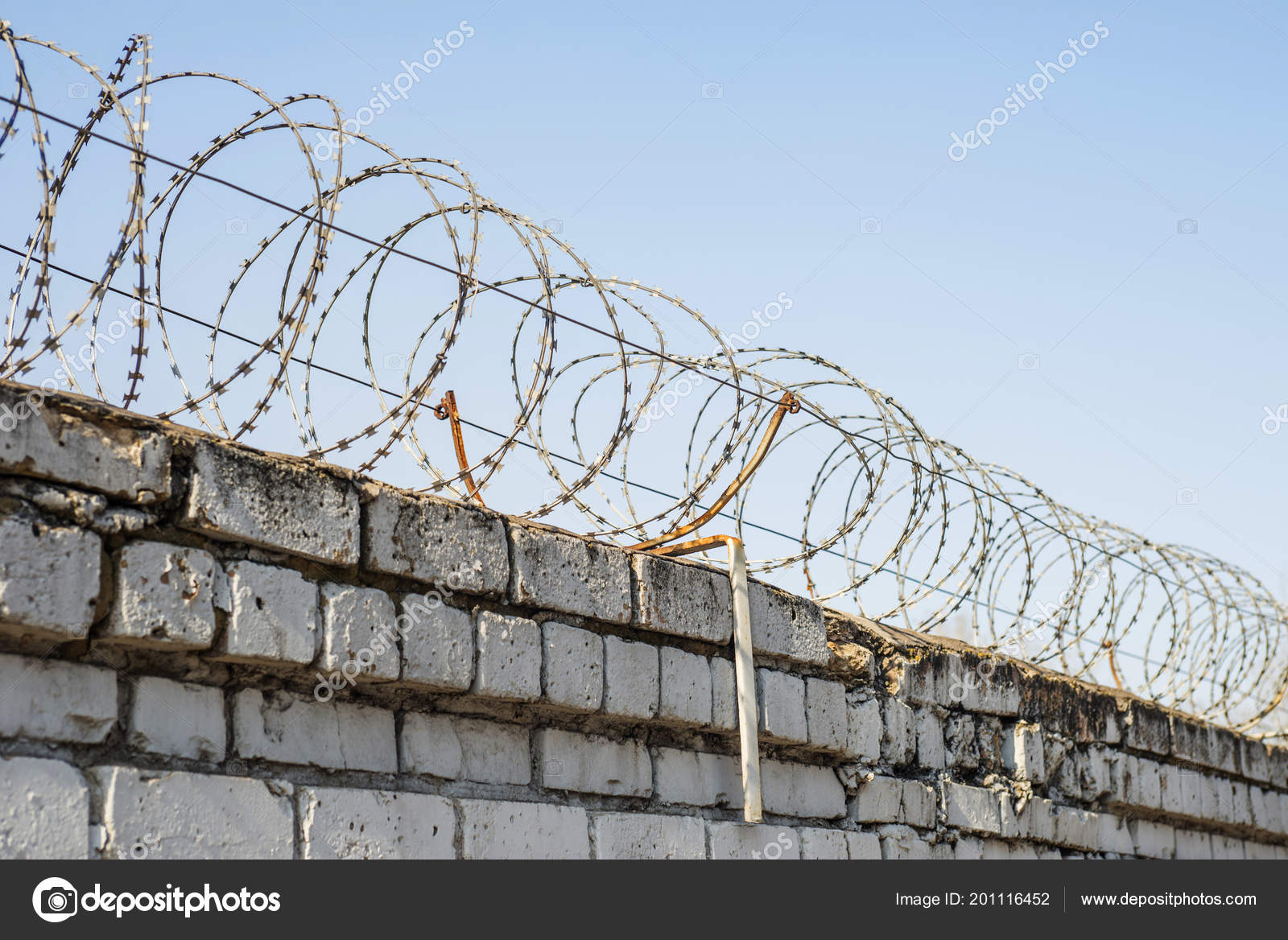 Barbed Wire Wound Top Brick Fence — Stock Photo © spyrakot #201116452