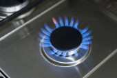 Burning gas, gas stove burner, hob in the kitchen. Blue gas stove in the dark
