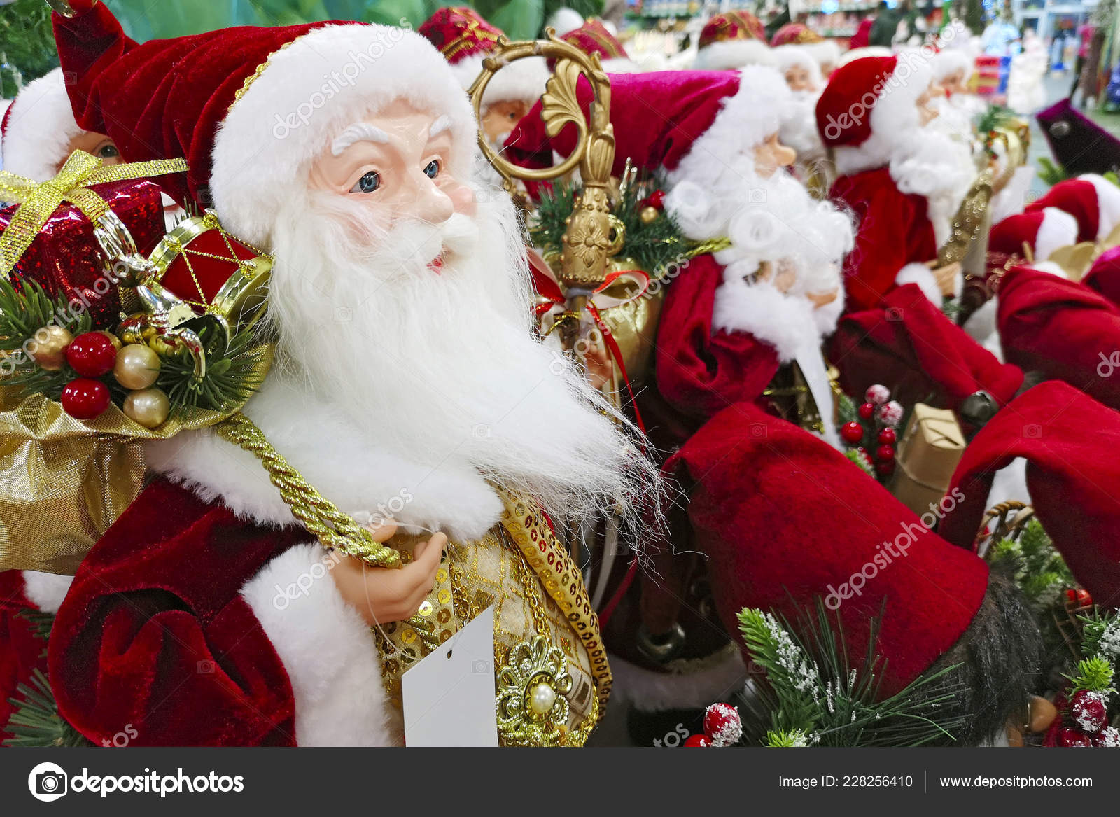 Christmas decorations Santa Claus toy in supermarket Santa s Christmas toys ts and souvenirs to decorate the Christmas tree on the counter in a