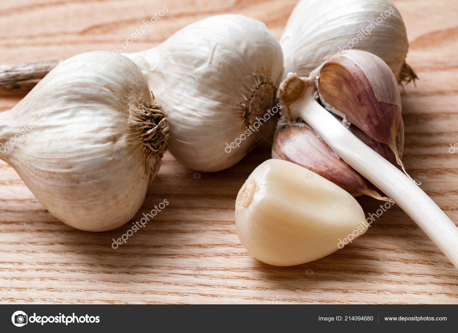 Garlic Head One Peeled Clove Garlic Close Wooden Background Stock Photo C Sasapanchenko Gmail Com 214094680