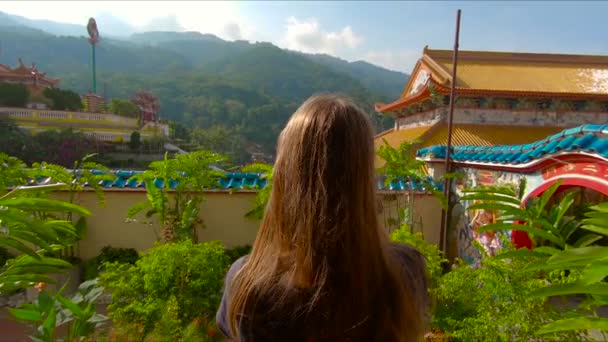 view of young woman in beautiful ancient place with colored buildings in Thailand