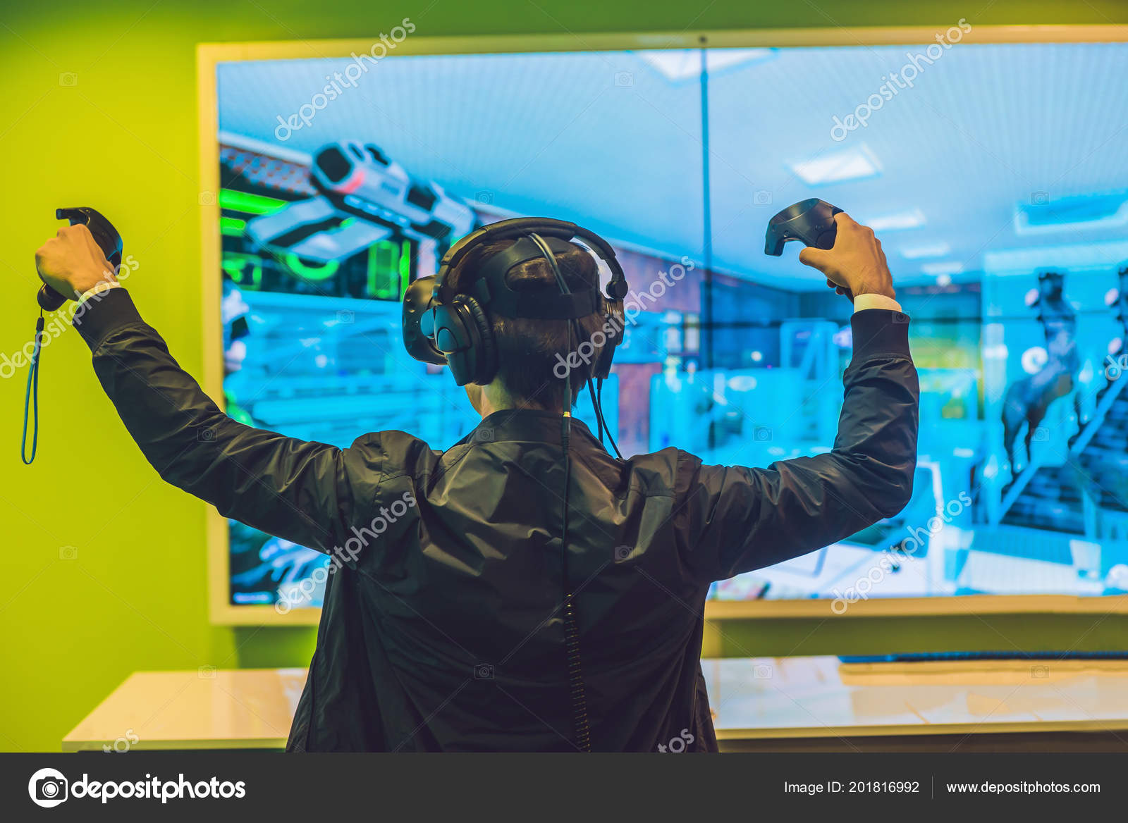 4890e76f6d7 Young man playing video games virtual reality glasses. Cheerful man having  fun with new trends technology - Gaming concept. — Photo by galitskaya