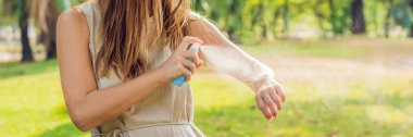 Woman spraying insect repellent on skin outdoor. BANNER, long format