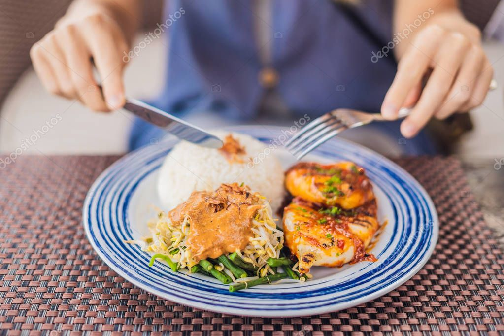 Squid grill with rice. Balinese cuisine Indonesia