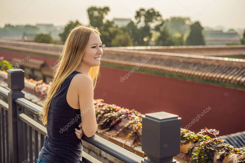 Enjoying vacation in China. Young woman in Forbidden City. Travel to China concept. Visa free transit 72 hours, 144 hours in China