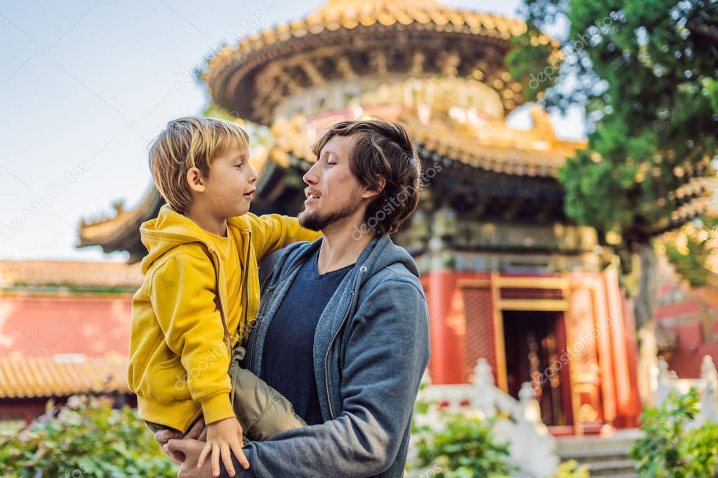 Enjoying vacation in China. Dad and son in Forbidden City. Travel to China with kids concept. Visa free transit 72 hours, 144 hours in China