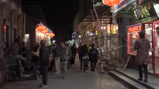 BEIJING, CHINA - OCTOBER 30, 2018: Hyperlapse shot of crowd of people in an old city centre of Beijing