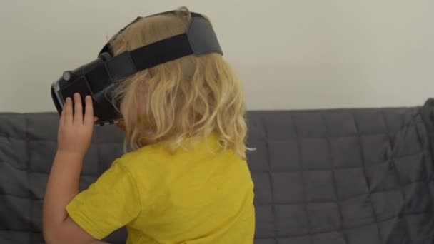 Closeup shot of a little girl using a virtual reality headset. VR glasses. VR concept. Children and modern technology concept