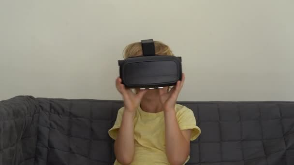 Closeup shot of a little boy uses a virtual reality headset. VR glasses. VR concept. Children and modern technology concept
