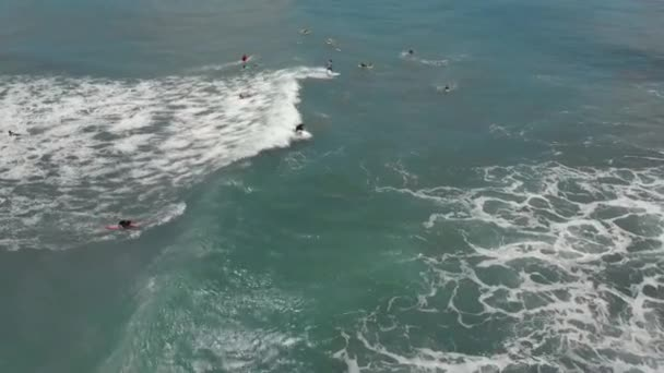 Aerial shot of a surfer riding on a wave