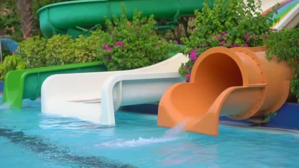 Slowmotion shot of a little boy that has fun on a water slide in a Water park. Summertime concept
