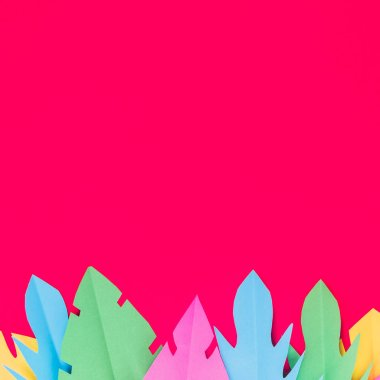 Multicolored paper tropical leaves on a bright pink background with a blank space for text. stock vector