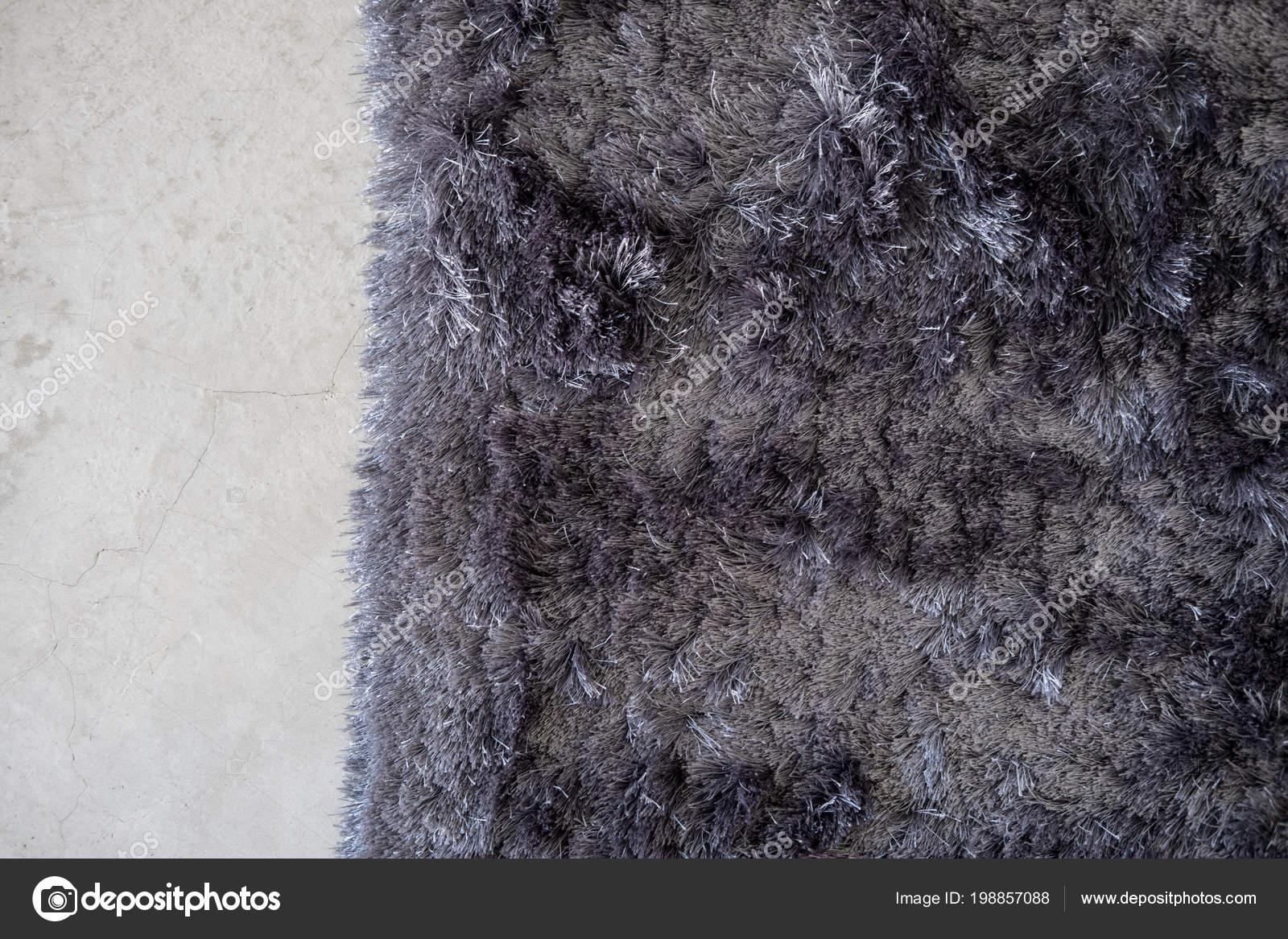 Grijze Interieur Ideeen : Donker grijze zachte tapijt cement vloer van bovenaf minimale