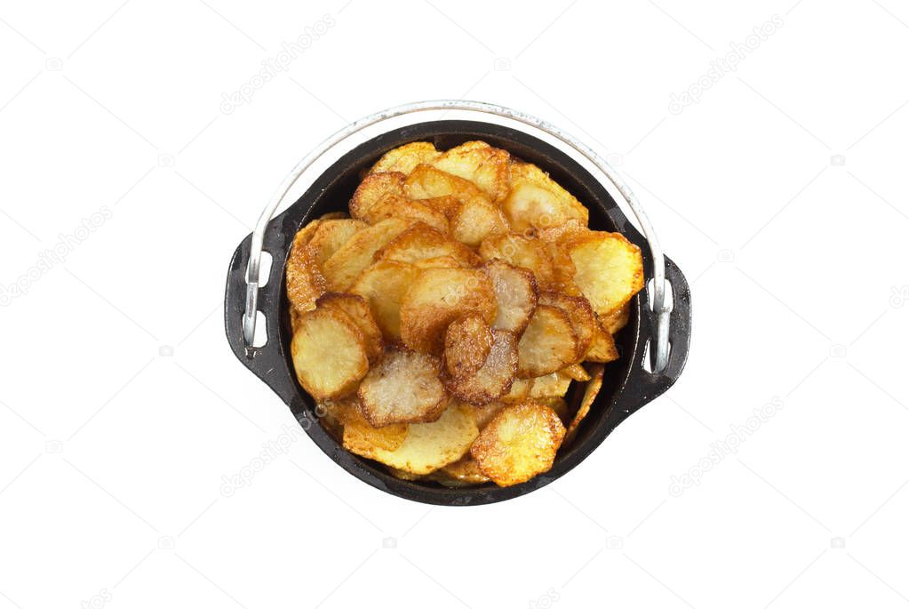 Fried potatoes lie in a cast-iron pot