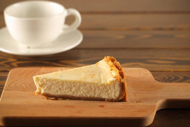 cheesecake cake portion stands on the table