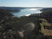 Fotografie Aerial view of Narrabeen Lake and its islands in Sydney (NSW, Australia) on a sunny day wintertime