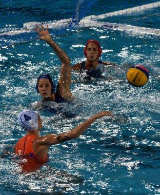 BUDAPEST, HUNGARY - JUL 20, 2017: SZUCS Gabriella (HUN) and GANGL Edina (HUN) goalkeeper defend against van der SLOOT Sabrina (NED) in the preliminary round of Waterpolo World Championship.