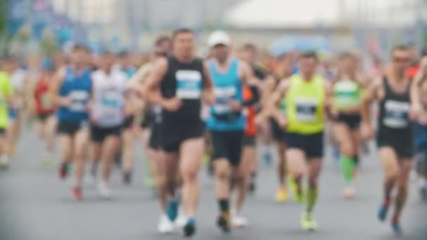 Sportsmen runners at the marathon in the city, blurred, slow-motion