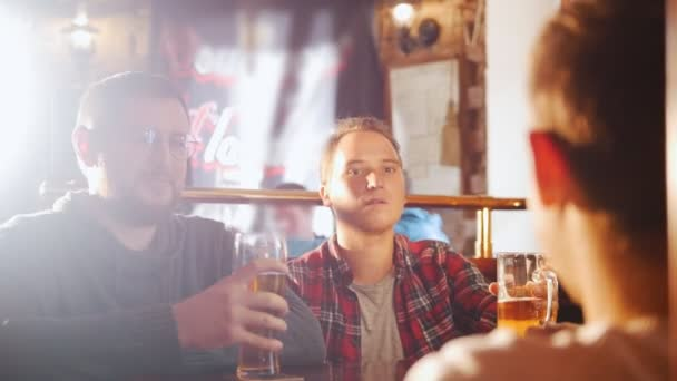 Three young men sitting in the irish pub drinking beer