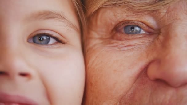 Close up portrait of grandmother and granddaughter. Bright blue eyes. Detailed