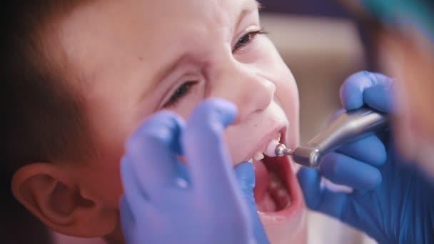 Dentistry. Dentist polishing kids teeth.