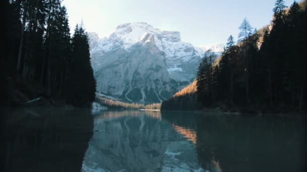 Dolomites. Beautiful overview of mountains and a forest and a lake. Static shot.