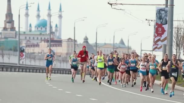 05-05-2019 RUSSIA, KAZAN: A running marathon. Different people running on the side of the road
