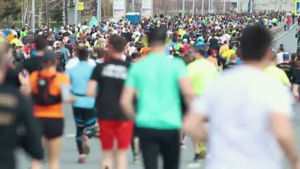 05-05-2019 RUSSIA, KAZAN: A running marathon. A crowd of people running on the road. Back view
