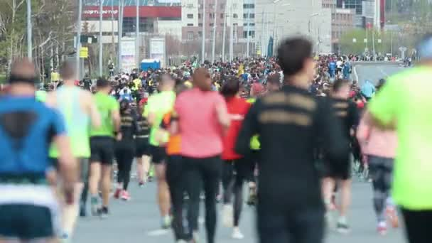 05-05-2019 RUSSIA, KAZAN: A running marathon in the city. A crowd of people running on the road. Back view
