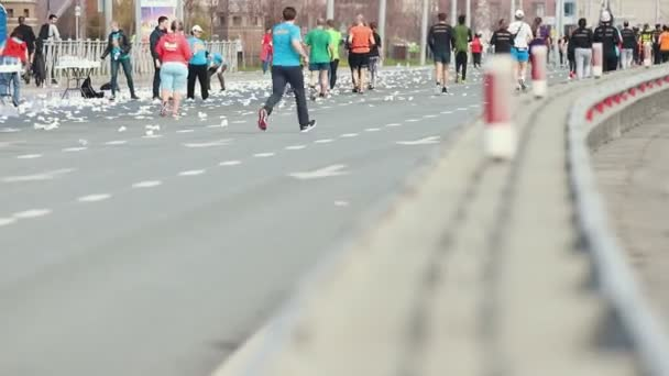 05-05-2019 RUSSIA, KAZAN: A running marathon in the city. A crowd of people running on the road covered in empty bottles of water