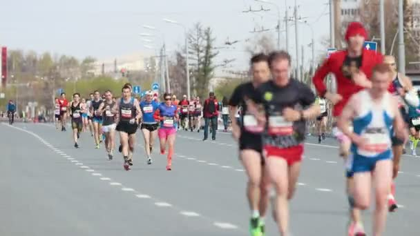05-05-2019 RUSSIA, KAZAN: A running marathon in the city. A crowd of active people running on the road
