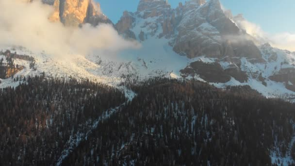 Breathtaking landscape of mountains with snowy summits and the green forest - Dolomites, Italy