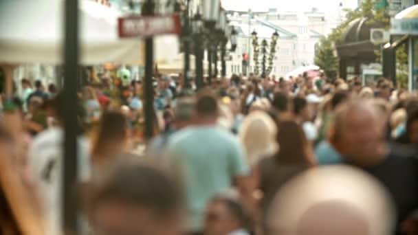 Big crowd of people walking on the streets - unfocused