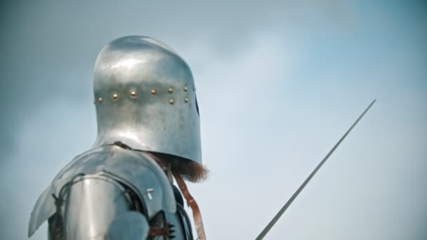 A man knight in the armor looking to the sky