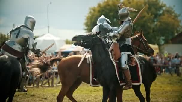BULGAR, RUSSIA 11-08-2019: Knights having a battle on wooden swords on the field - medieval festival