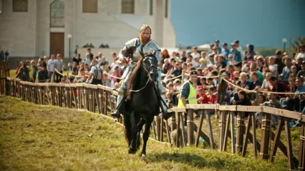 BULGAR, RUSSIA 11-08-2019: A bearded man knight riding a horse near the fence while the fight tournament