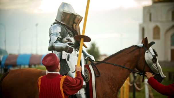 BULGAR, RUSSIA 11-08-2019: a man assistant gives the spear to a knight